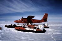 Tiger 4 hovercraft as used in the 70s by the British Antarctic Survey - Two Tiger 4 craft in front of the island hopping transport plane (Malcolm Hole).